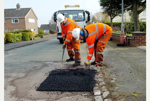 Staffordshire Invests 2.1million to Fix Potholes - Tack Coats to Improve Your Asphalt Paving Driveways